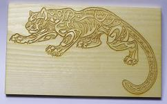 Jaguar on wood